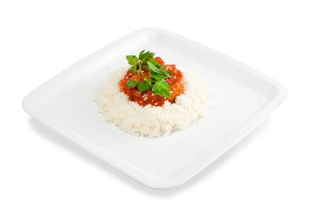 Rice with meat and vegetables with tomato sauce on a white background Stock Photo