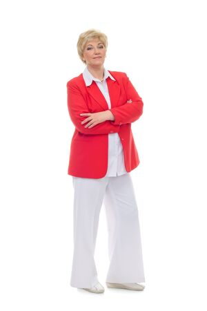 Portrait of a smiling adult woman in a red jacket standing with folded hands isolated against white background Stock Photo - 12544327
