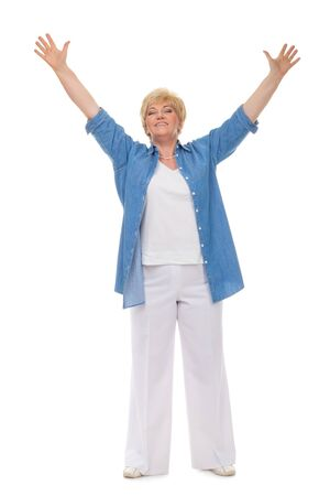 Portrait of a smiling adult woman in a blue shirt welcomes isolated against white background photo