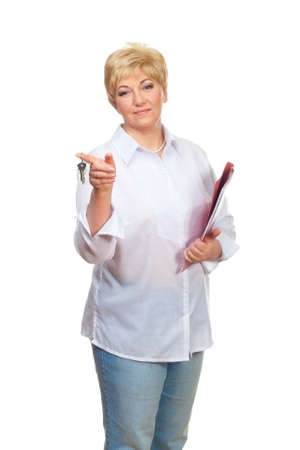 Portrait of a smiling adult woman with folder and key isolated against white background