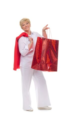 shoppingbags: Portrait of a smiling adult woman with shopping bags  isolated against white background