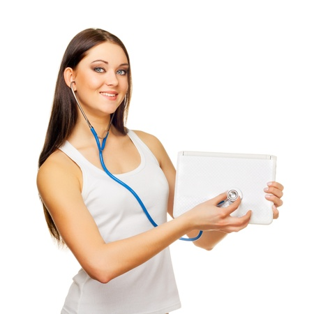 The young woman test the laptop with a tonometer on a white background