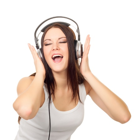 Beautiful girl listens to music through ear-phones on a white background Stock Photo - 12544409