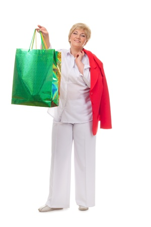 Portrait of a smiling adult woman with shopping bags  isolated against white background