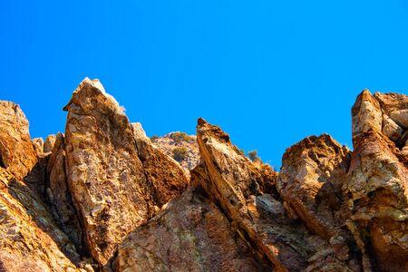 big sharp rocks in a sunny day photo
