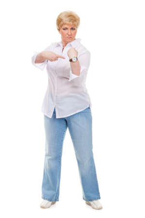 Senior womanshows the watch isolated against white background