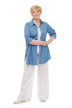 Portrait of a smiling senior in a blue shirt isolated against white background