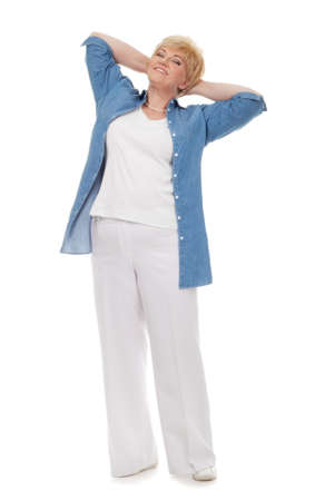 Portrait of a smiling senior in a blue shirt isolated against white background Stock Photo - 12713754