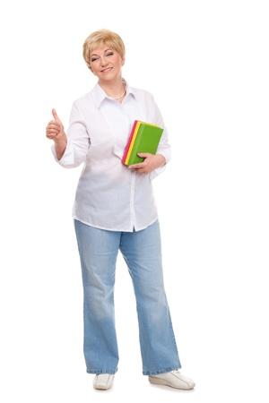 Senior woman holding books and showing OK isolated against white background Stock Photo