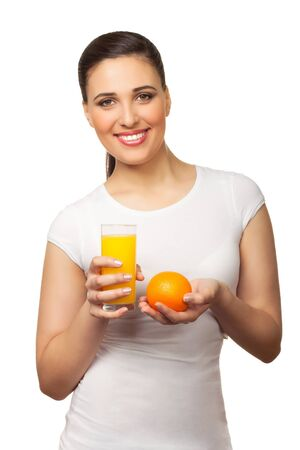 Beautiful young woman with orange and juice on white background photo