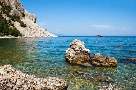 The yacht sails from the rocky sea coast  Marmaris  Turkey  Stock Photo - 14505130