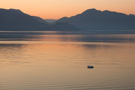 Lonely boat in the sea on sunrise  in a calm  Pastel tones  Marmaris  Turkey