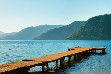 mountains and old wooden pier to the sea  Marmaris  Turkey
