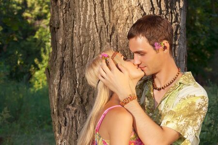 young man kisses fine young woman  style of hippie photo