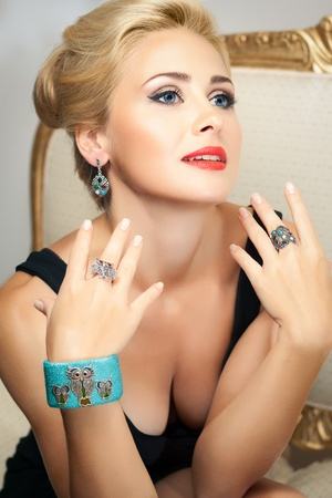 Elegant fashionable woman brags of jewelry  Fashion shoot  photo