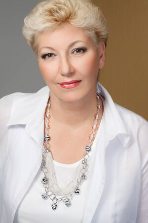 elegant blond senior with jewelry photo