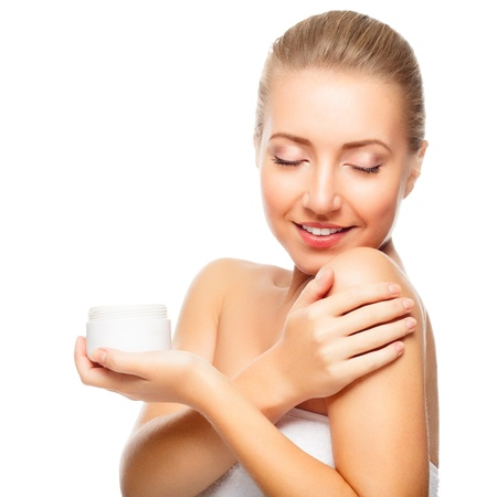 Beautiful blond woman tender jar of moisturizer cream. Close-up fresh young woman face. isolated on white Stock Photo