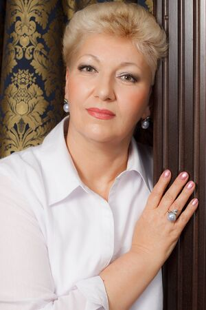 elegant blond senior with jewelry Stock Photo - 16638865