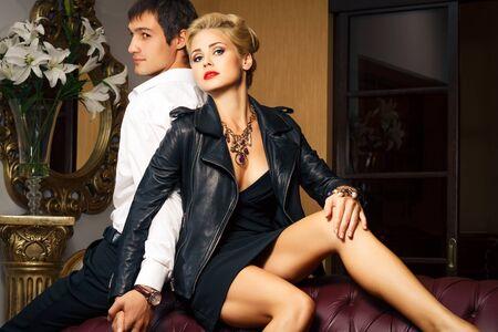 young man and beautiful young woman in beautiful interior. Fashion shoot. Stock Photo