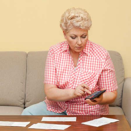 beautiful senior calculating her debts