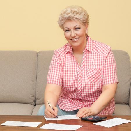 happy senior calculating her debts