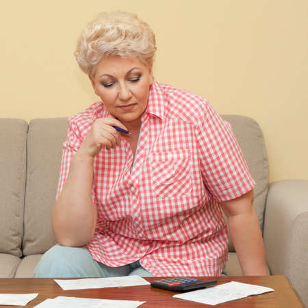 woman thinks about her debts