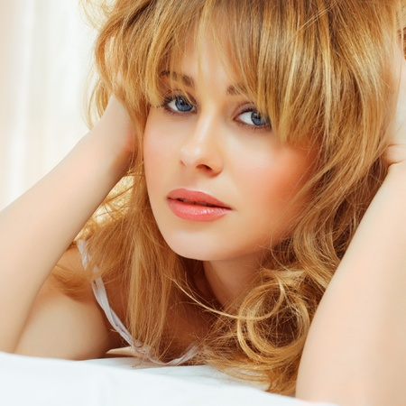 blond young woman in bed
