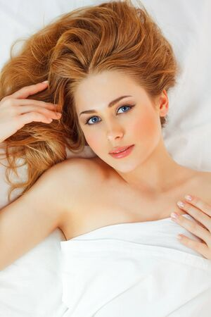 beautiful young woman in bed