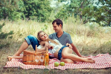 young beautiful couple have a rest on picnic photo
