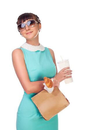 woman brunette in turquoise dress in sunglasses with fast food in hands on white background Stock Photo - 21307487