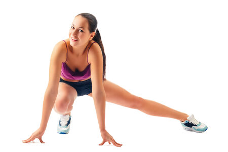 young woman in sportswear does exercises on white background Stock Photo
