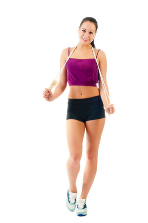 young woman with jump rope on shoulder  in sportswear isolated on a white