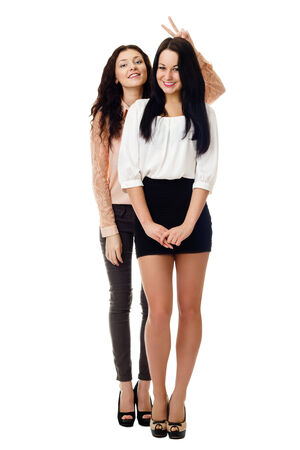 kidding: two young standing women amuse oneself and have fun Stock Photo