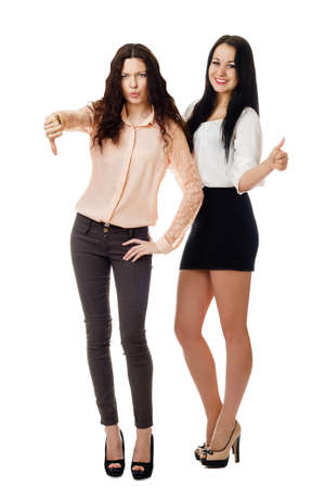 two beautiful young women standing and showing like and dislike gesture
