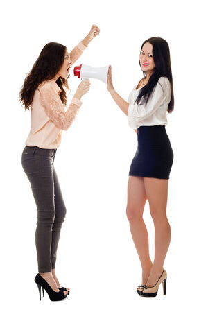 two smiling young standing women crying in megaphone one from them sly smiling