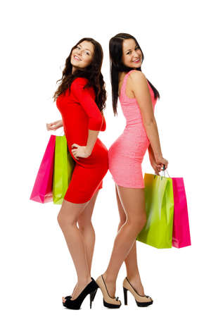 two young beautiful shopping merry women