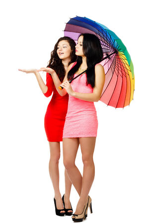 two young walking women with umbrella