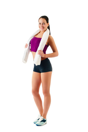 young woman with towel on neck stands Stock Photo