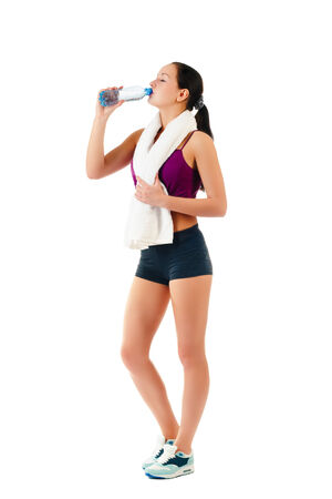 young woman with towel on neck drinks water