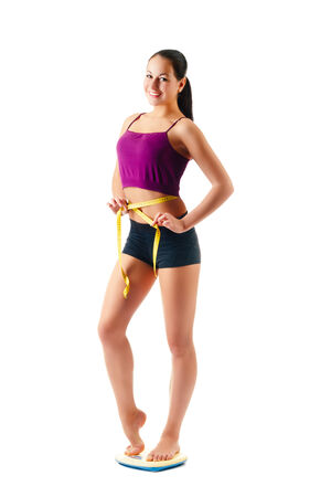 young woman with a measure tape around her waist