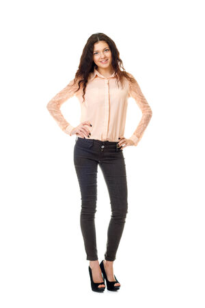 young woman in dark jeans and light shirt