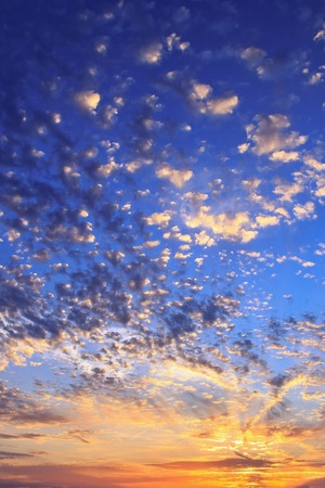 sunset sky with spotted clouds vertically