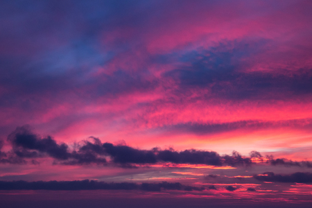 abstract sunset sky background with wind clouds