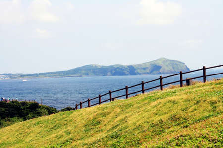 summer country view of Jeju Island with sea and island in the background