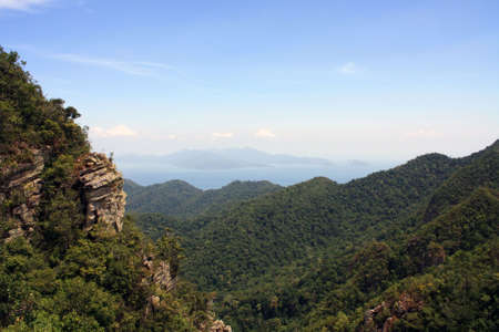 View of peaks of mountain and the sea and island in the horizon from a high altitude