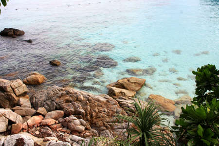 rocks and clear sea view at Perhentian Island from an elavated view Stock Photo