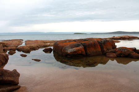 Red rocks at Coles Bay and calm waters, Tasmania