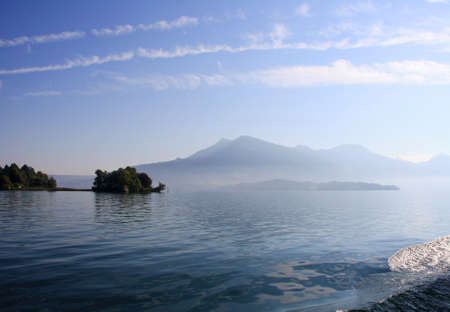Misty Lake Lucerne with mountains fading in the mist photo