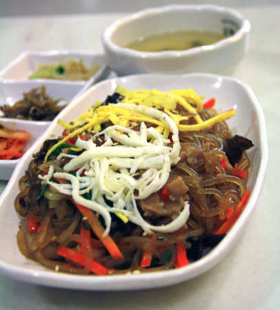 sides: Japchae, Korean glass noodles, background soup and sides Stock Photo