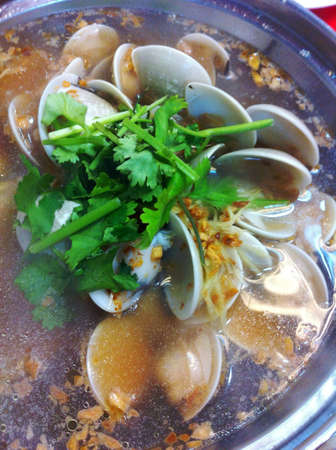 steaming hot pot of clam soup